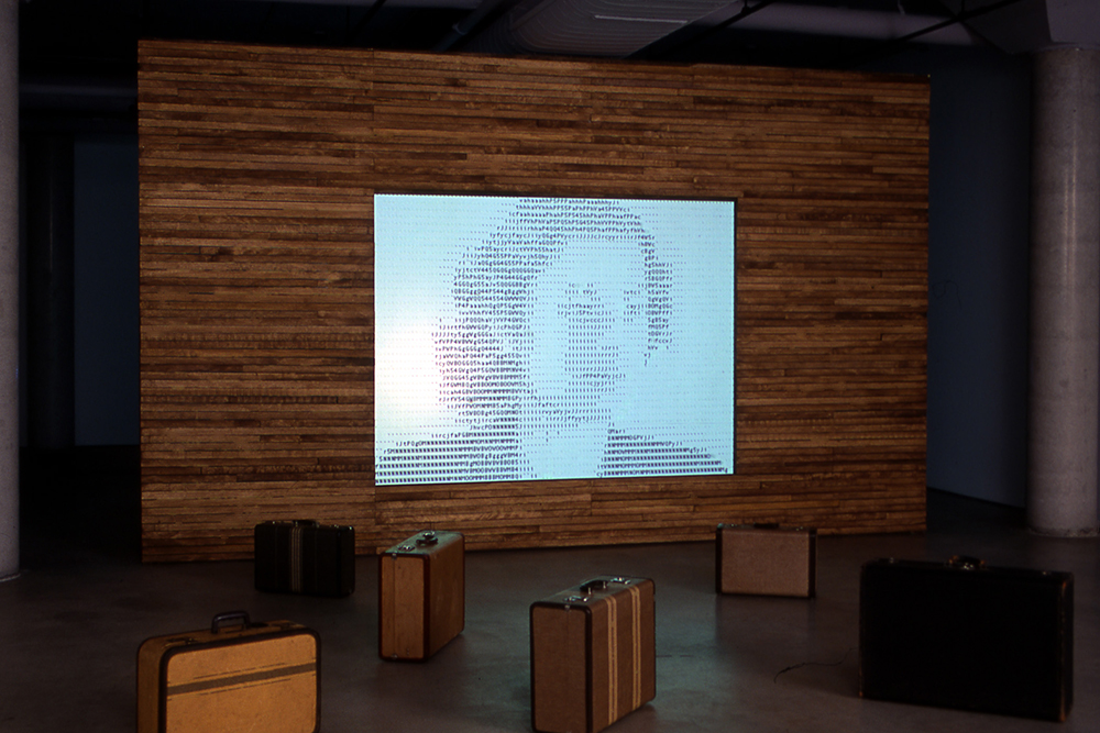 Suitcase Room with ASCII portraits