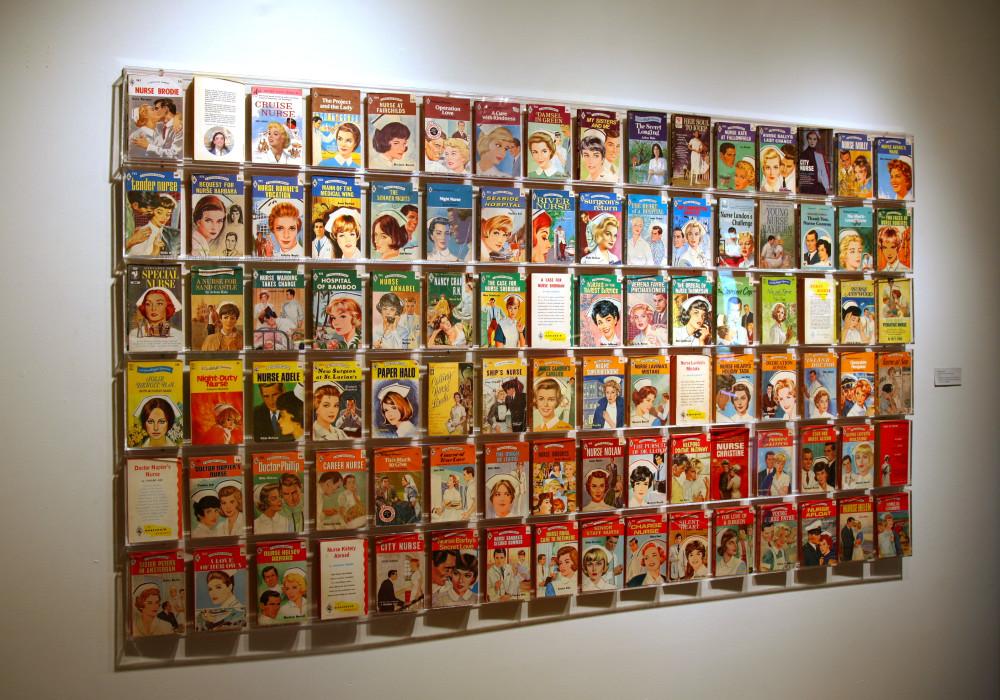 "Books, acrylic shelving 96"" x 48"""